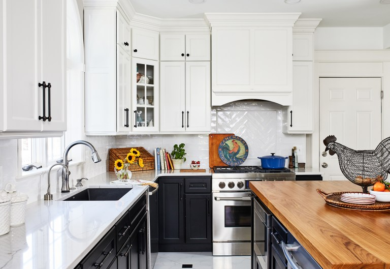 case kitchen design with white cabinets with black handles and white backsplash