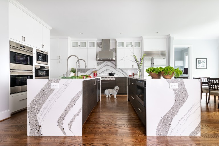 two white, marble island, one with double sink the other has pull drawers with lots of space