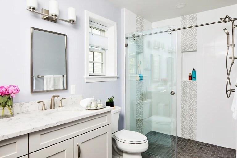 home design bathroom with single sliding frameless shower door with rolling disk