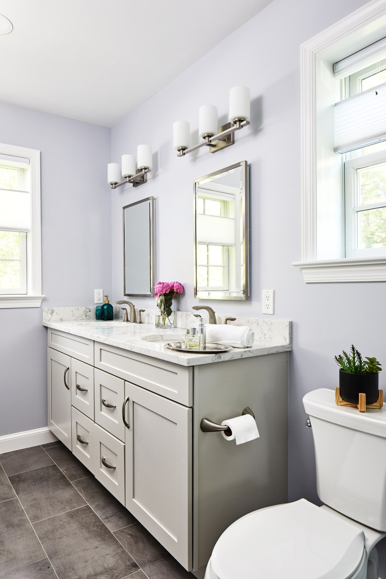 transitional bathroom with white double bathroom vanity set with mirror