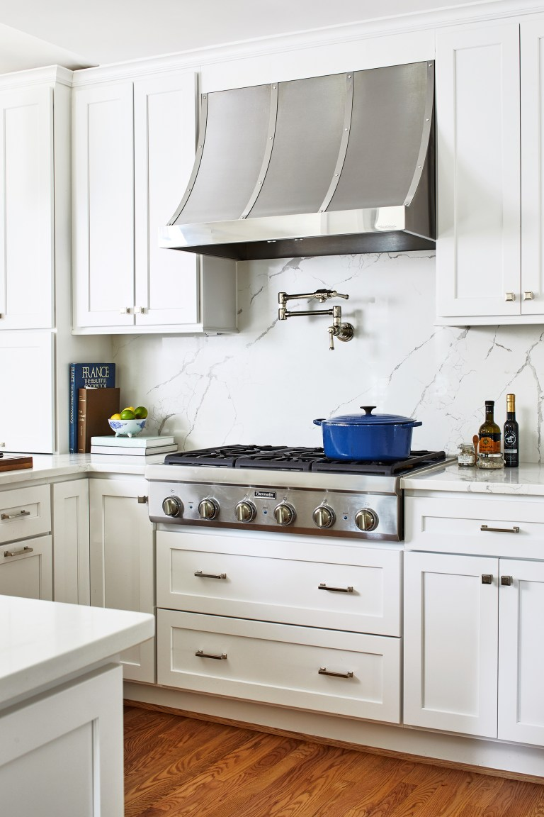 range hood over 6 burner stove with two sliding drawers with pull handles