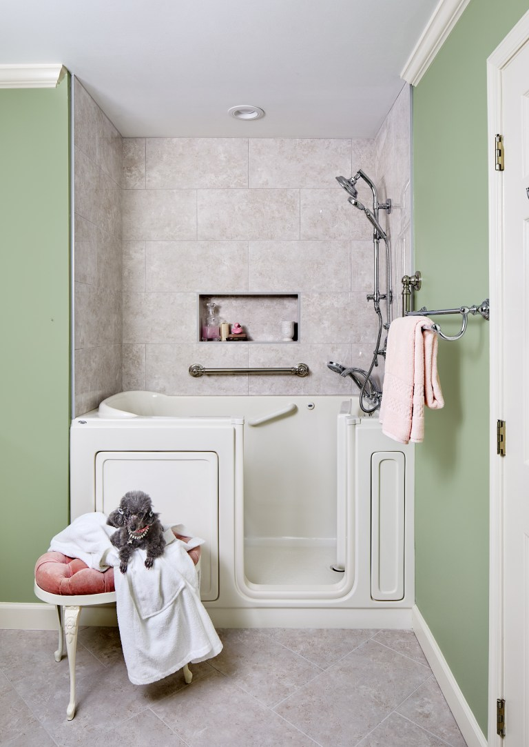 bathroom with walk-in combo tub with grab bars