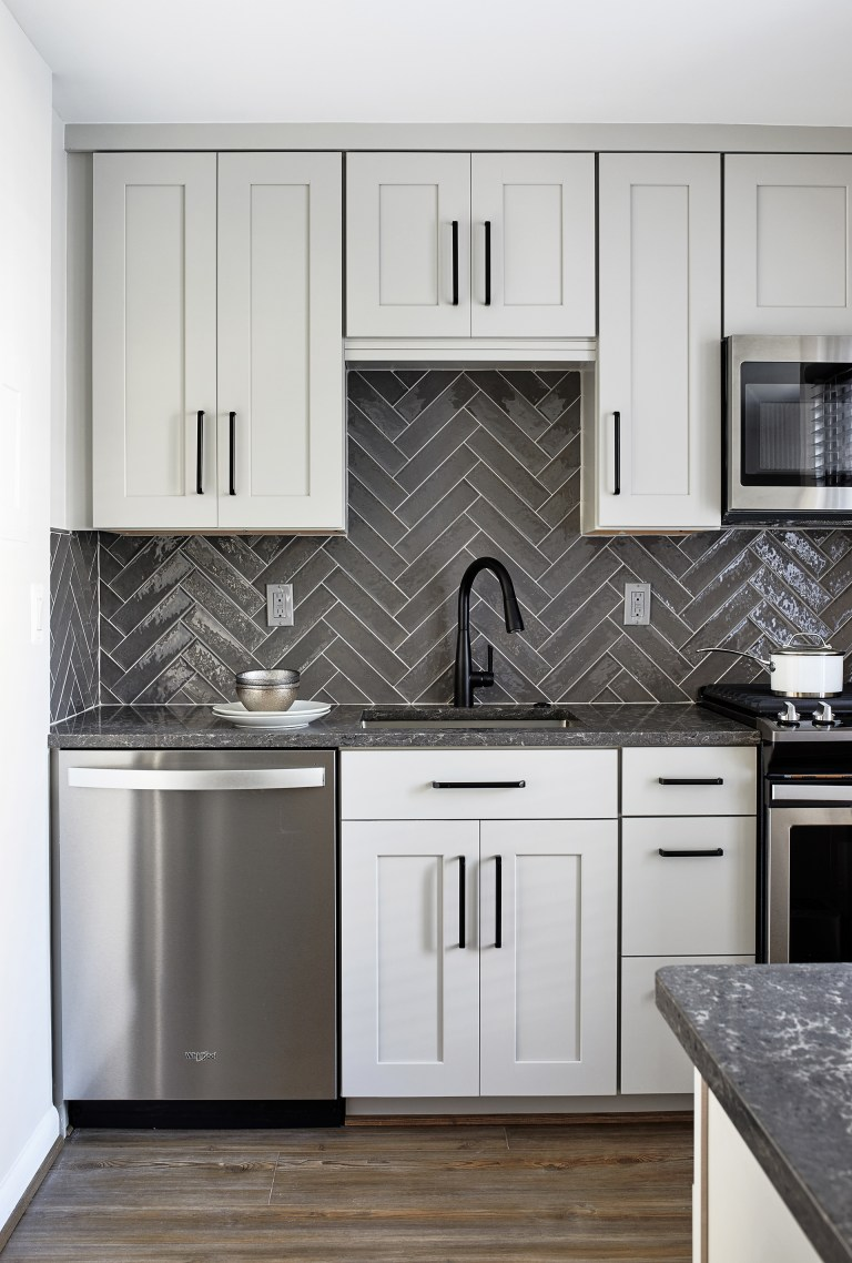 case design remodeling kitchen, wood hardwood floors and subway grey cabinets, stainless steel appliances
