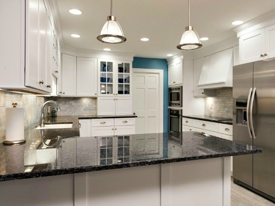 A complete kitchen remodelling project that saw outdated, dark oak cabinets come back to life in this newly re-imagined bright white space