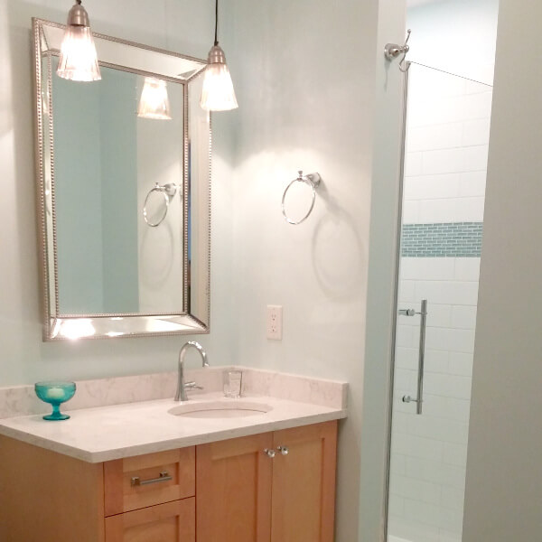 bathroom update clean white marble vanity with blue glass accent tiles