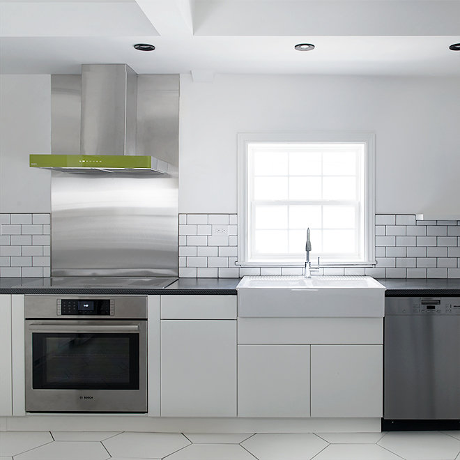 white kitchen open shelves green range hood hexagon floor tile