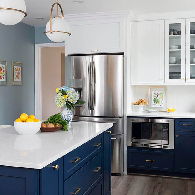Navy and white kitchen remodel, stainless steel appliences, white quartz counters, pendant lights - Halifax Case Design