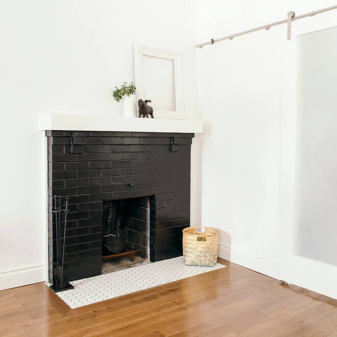 refurbished fireplace, hearth tile, and hardwood flooring with sliding barn door to kitchen Case Halifax