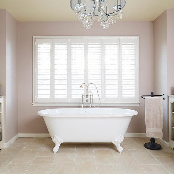 Bathroom addition with stand alone clawfoot tub bedford