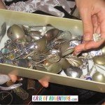 Inside the CASE OF ADVENTURE - silver souvenir spoons!