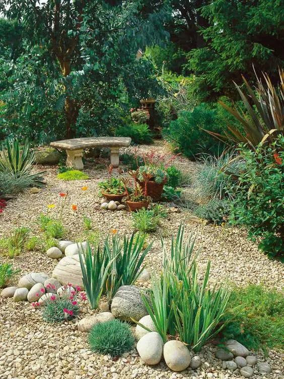 amenajarea gradinii cu pietris Pebble garden decoration ideas 23