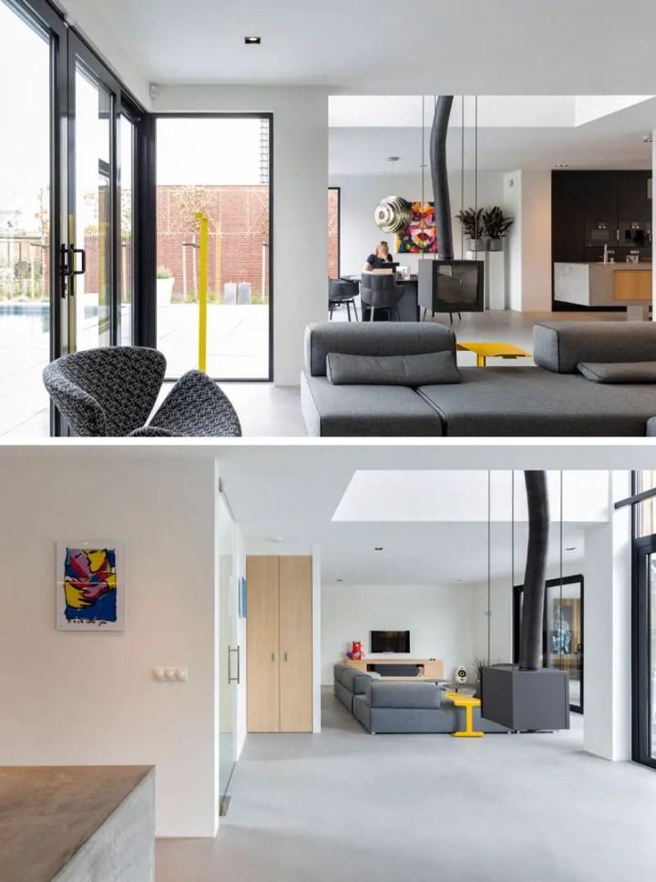 Casa cu ferestre in relief - interioare aerisite, dominate de nuante de gri