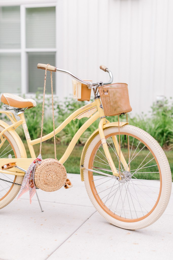 Yellow Huffy bicycle with vintage purse.
