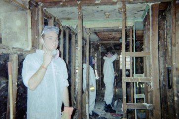 Gutting a flooded house in the lower 9th Ward, with Common Ground Relief, after Hurricane Katrina.