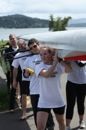 """Lifting the """"shell"""" with the Evergreen rowing team."""