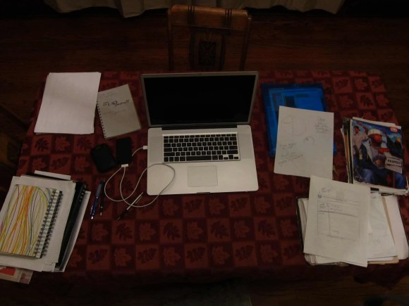 A photo of our dining room table which often doubles as my workspace.