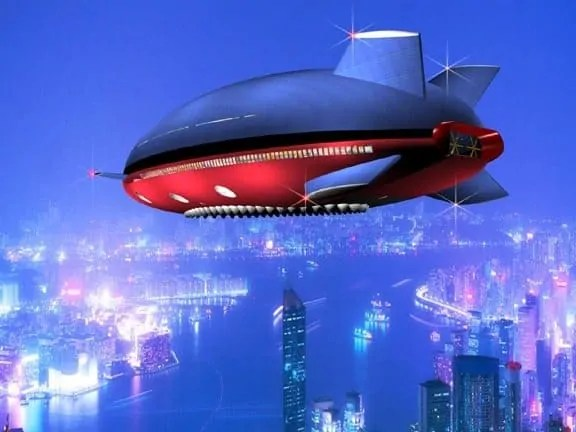 A view of a blue and red blimp in a futuristic cityscape.