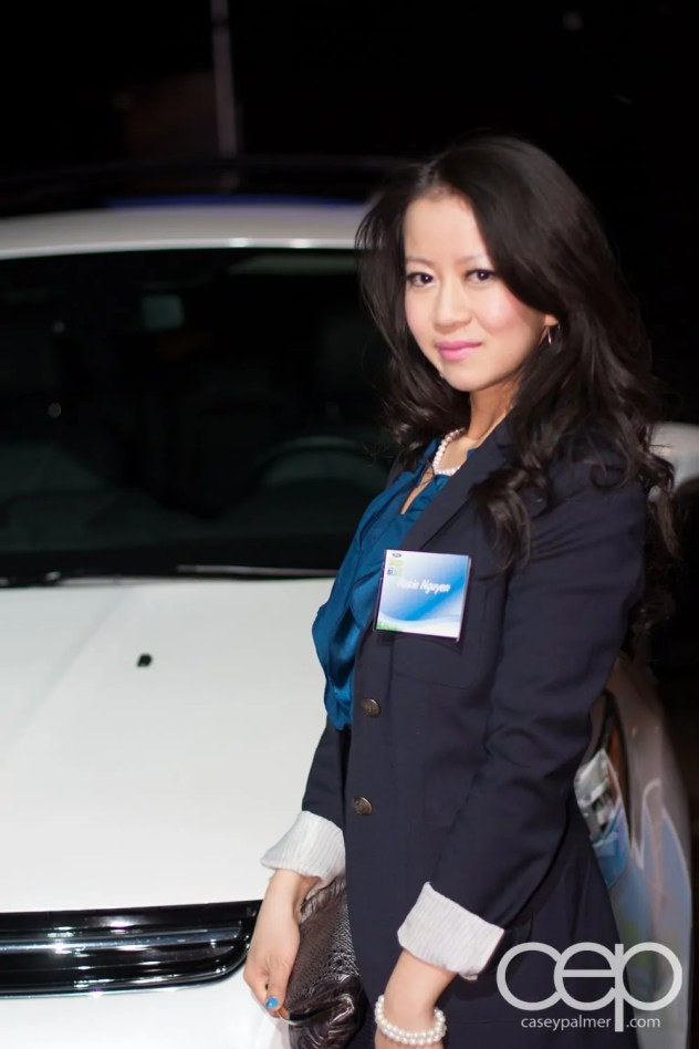 Rosie posing next to a 2013 Ford Fusion