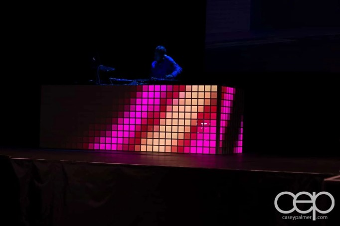 DJ Clymaxxx on a DJ table flashing ALL sorts of colours!