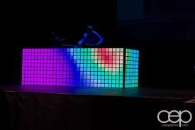 DJ Clymaxxx on a DJ table flashing ALL sorts of colours!