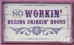 "A sign at Grover's reading: ""No Workin' During Drinkin' Hours"""
