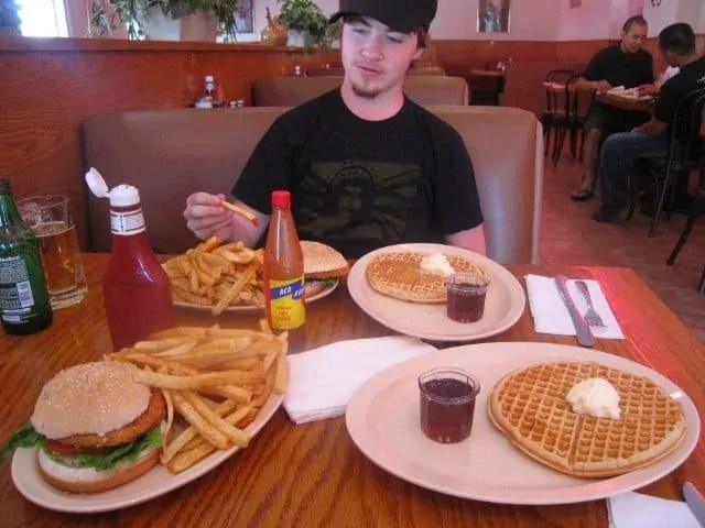 Jon Barker at Roscoe's House of Chicken & Waffles with some MASSIVE plates of food before him for a birthday feast!