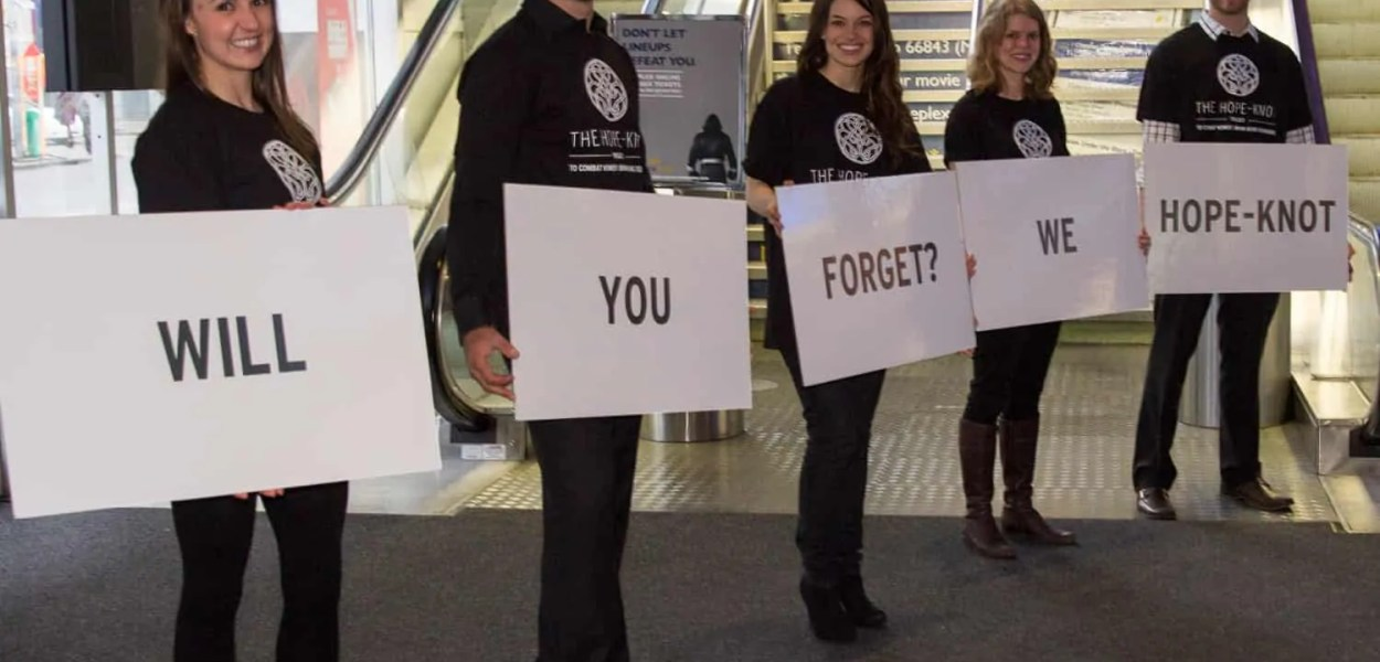 "Clever volunteers at the Women's Brain Health Initiative launch party spelling ""Will You Forget? We Hope-Knot!"""