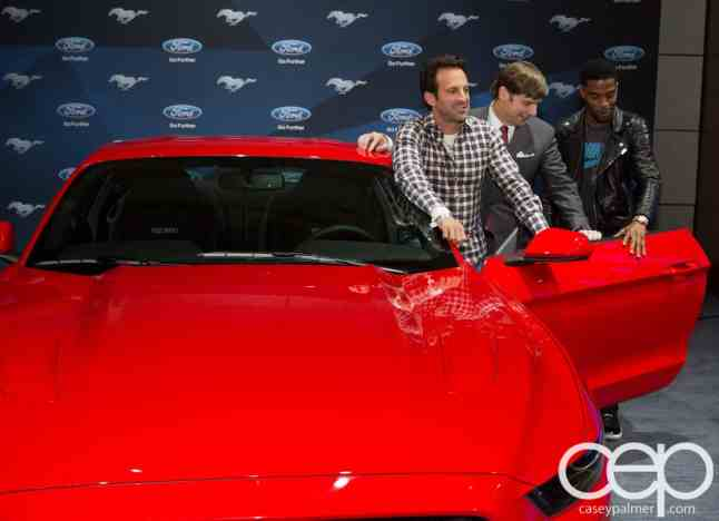 #FordNAIAS 2014 — Day 2 — Cobo Hall — Behind the Blue Oval — Need for Speed Screening — Scott Waugh, James D. Farley, Jr., Executive Vice President of Global Marketing, Sales and Service and Lincoln, Ford Motor Company, and Scott Mescudi (aka Kid Cudi) with the 2014 Ford Mustang