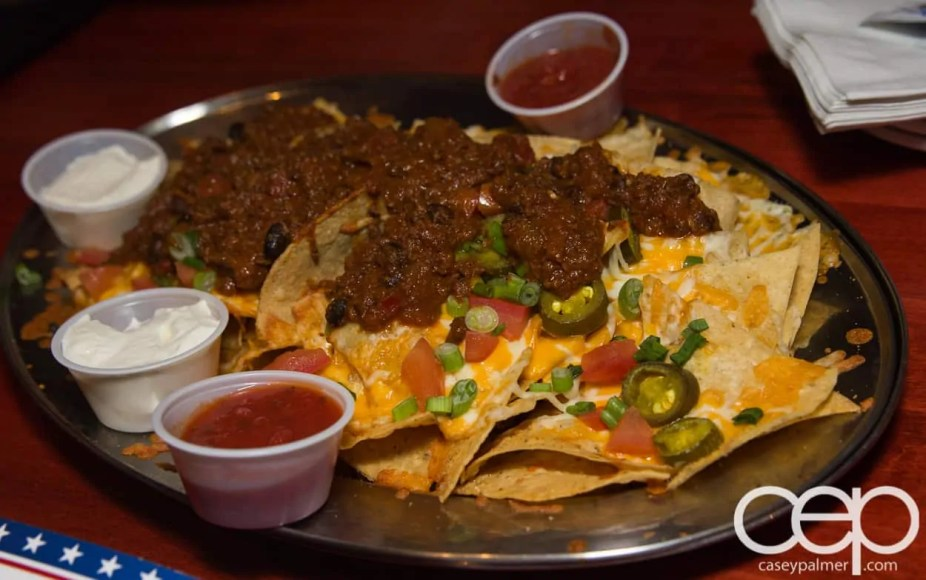Team Trolling — All-Star Wings and Ribs — All Star Nachos — Freshly prepared Naho Chips topped with a 1/2 lb. of cheese, diced tomato, jalapenos, and shallots. Served with salsa and sour cream.Add 'Certified Angus Beef' brand chili (4 oz.)Add grilled chicken (5 oz.)Add pulled pork