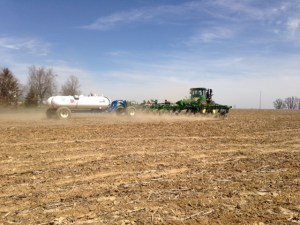 There goes John in the 9360R pulling the 2510H applicator.  A 60-foot swath with every pass.