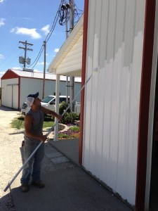 Brandon applies a good coat of white paint to the shop... and it's a nice day to do it.