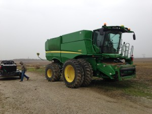 This was the S680 combine they brought us yesterday to demonstrate the John Deere flex-draper header.  We  replaced the fuel we burned yesterday before they took the machine back to the dealership this morning.
