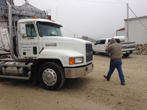 John pulls up his hood to get to the loaded truck.  He's headed to GPC at Washington