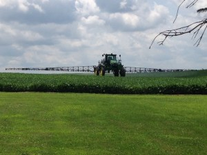 John operates the 4730 sprayer behind our house today in those beautiful soybeans!