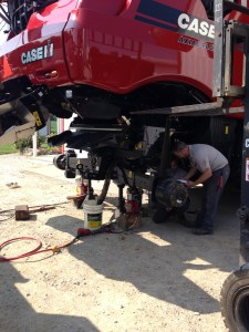 Another view of the combine rear axle work.
