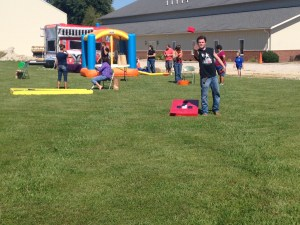Corn hole was a popular game for everyone, and the kids loved the two 'bouncy houses'.