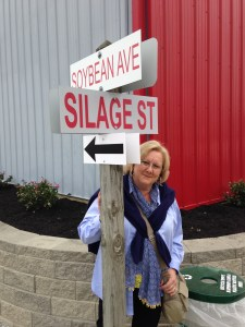 Pat poses for a picture at the corner of Soybean Avenue and Silage Street in the exhibit field of the FSR