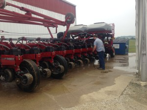 Here, John washes on the C-IH 1250 corn planter.