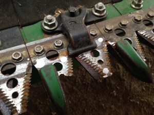 Here is a broken 'section' in the knife of our JD 640FD header.  John has marked it with white paint to be replaced.