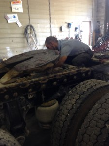 Brandon installs replacement shock absorbers on the Vanna truck.