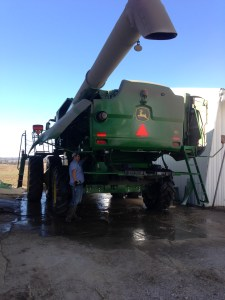John has begun the task of washing up the S680 combine. It's the final piece of machinery to hit the wash pad. It's a remarkably warm day for this work. Often we are shivering when we wash for the final time after harvest! Not today... it's gonna be in the upper 70s!