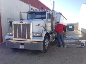 John is washing the Peterbilt again today, after getting it a little messy while driving through some light rain yesterday on his way to and from ADM at Newburgh.  I-69 makes that trip even easier!