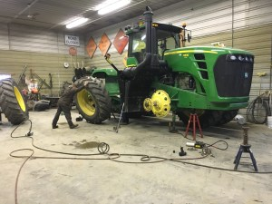 Ray rocks the inner tire back and forth to 'walk' it away from the tractor.
