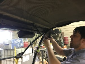 John has installed the antenna, and now works on the other wiring need for the installation. All these wires will be hidden inside the new overhead radio panel.