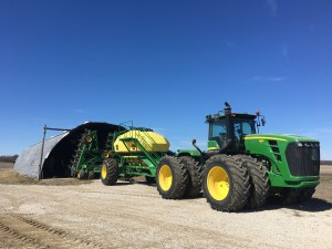 We pull out the JD air drill to take it home to prepare for spring planting. Yes, it's a tight fit, and a real challenge to get it backed in there!