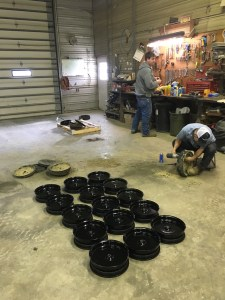 Some wheels dot the shop floor as one-by-one we take apart the old gauge wheels, and assemble the new ones. We re-use the tire on most.