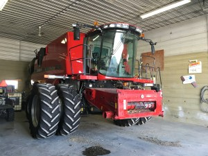 Wjhen a combine comes into our shop, it just seems 'bigger' than when it sits outdoors.  Here the 8230 is positioned in the shop for maintenance.
