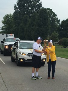 Here, John receives the 'hand off' from Martha Turner, who at 88 is one of the oldest Hoosiers to carry the Torch.