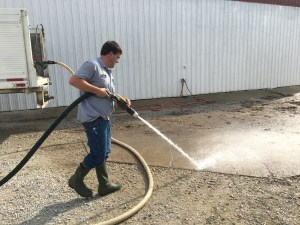 Lastly, the mud and residue and other sloppy debris is pressure washed from the wash pad itself.