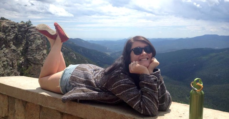 Anna resting on a ledge in Colorado